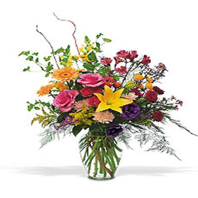 Renkli mevsim çiçeklerinden oluşan cam vazo aranjman