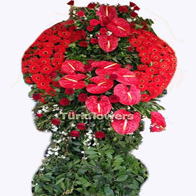 Kırmızı çiçeklerden oluşan cenaze çelengi