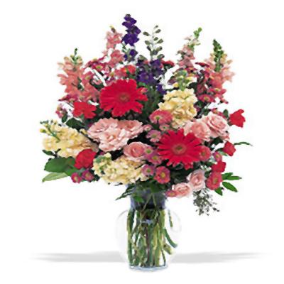 Renkli mevsim çiçeklerinden oluşan cam vazoda aranjman